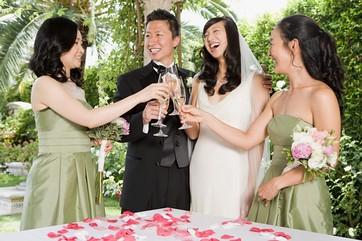 Newlyweds and bridesmaids